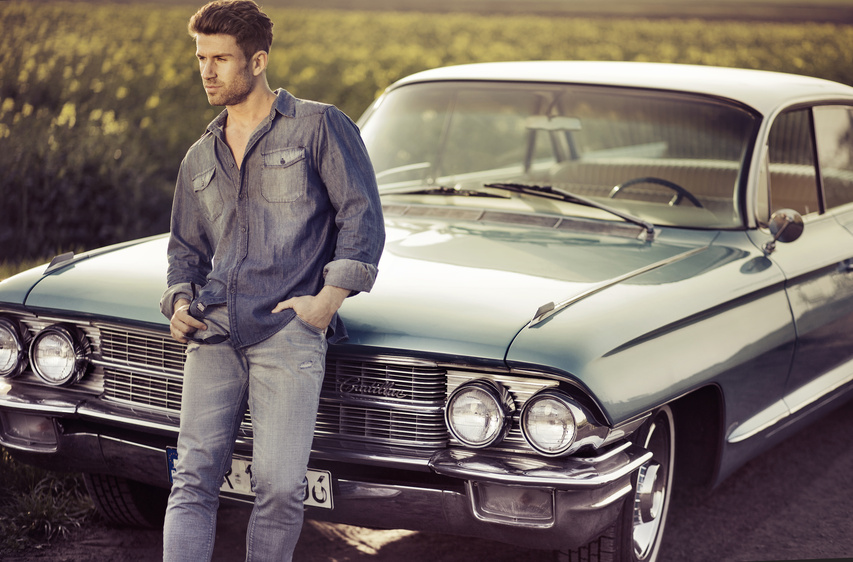 Elegant male model with the retro car
